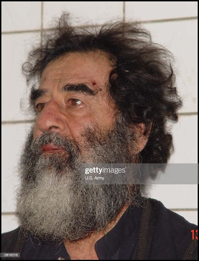 A handout photo of Saddam Hussein after his capture is seen December 14, 2003 in Iraq. U.S. troops captured Saddam Hussein near his home town of Tikrit. DNA tests have confirmed that the man captured by U.S. forces in Tikrit was ousted president Saddam Hussein.