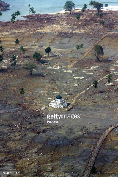 A handout photo shows a mosque still existing after the quake and tsunami that hit Aceh province early 26 December 2004 in Meulaboh West Aceh 01...