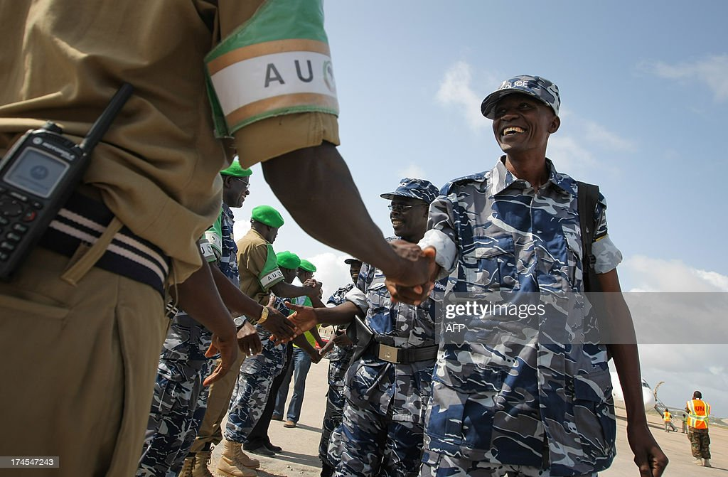 A handout photograph taken and released by the African Union-United Nations Information Support Team on July 27, 2013, shows Ugandan police officers arriving at Aden Abdulle International Airport in Mogadishu, to begin a one-year tour serving as formed police units with the African Union Mission in Somalia (AMISOM). The incoming 135 police officers replace a previous unit of the same number that completed their deployment and rotated back to their home country of Uganda. AFP PHOTO / AU-UN IST PHOTO / STUART PRICE CREDIT 'AFP PHOTO / AU-UN IST / STUART PRICE' - NO