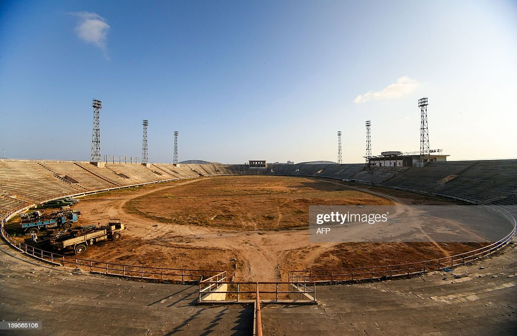 A handout photograph taken on January 12, 2013 and released on January 16 by the African Union-United Nations Information Support Team, shows a view of the former football pitch inside Mogadishu National Stadium. Formerly a main base for the Al-Qaeda-allied violent extremist group Al Shabaab, the once impressive stadium was used as a headquarters for the group's operations in Mogadishu, a training ground for their fighters and a site where they executed prisoners and tested and assembled improvised explosive devices (IEDs). After two decades of near-constant conflict, Somalia is enjoying its longest period of peace and growing security since the Al-Qaeda-allied violent extremist group Al Shabaab was driven from Mogadishu in August 2011. Under the Shabaab's draconian rule, social pastimes and sports such as football were banned but residents of the city and elsewhere across Somalia.