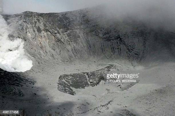 Handout picture released by Costa Rica's Sismic and Volcanalogical Observatory of the crater of the Turrialba volcano in eruption some 65 km...