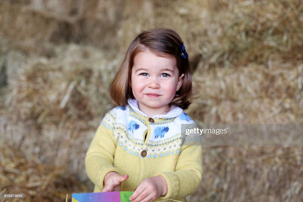 TOPSHOT - A handout picture released by Kensington Palace and Britain's Duke and Duchess of Cambridge on May 1, 2017 and taken by the Duchess shows Princess Charlotte of Cambridge at Anmer Hall in the village of Anmer in Norfolk, eastern England, in April, 2017. A new photograph of Britain's Princess Charlotte at her family's country home was released by the royal family on May 1, 2017 to mark her second birthday which falls on May 2. The photograph was taken by her mother, Catherine, Duchess of Cambridge, in April 2017 at Anmer Hall, the secluded house in Norfolk, eastern England, where the family spends much of its time. / AFP PHOTO / KENSINGTON PALACE / The Duchess of Cambridge / RESTRICTED TO EDITORIAL USE - MANDATORY CREDIT ' AFP / KENSINGTON PALACE / THE DUCHESS OF CAMBRIDGE ' - NO