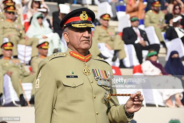 A handout picture released by Pakistan's InterServices Public Relations shows outgoing Pakistan army chief General Raheel Sharif hands over change of...