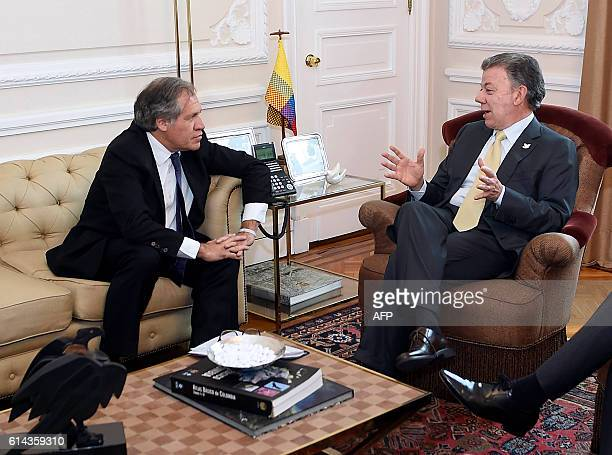 Handout picture released by the Colombian Presidency showing Colombian President Juan Manuel Santos talking with the Secretary General of the...