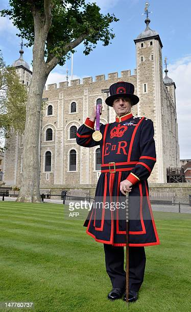 A handout picture released by the London Organising Committee of the Olympic and Paralympic Games on July 2 shows a Yeoman Warder or 'Beefeater'...