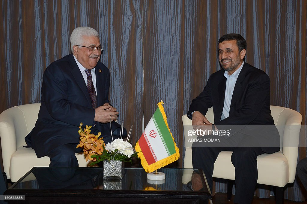 A handout picture released by the Palestinian Authority Press Office shows Palestinian president Mahmud Abbas (C) talk with Iranian President Ahmadinejad during a meeting on the sideline of the Organisation of Islamic Cooperationon summit on February 6, 2013 in the Egyptian capital Cairo. AFP PHOTO/HO/PPO --- RESTRICTED TO EDITORIAL USE - MANDATORY CREDIT 'AFP PHOTO/ PPO /HO' - NO