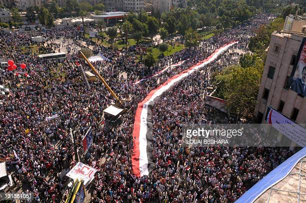 CREDIT 'AFP PHOTO / SANA' NO A handout picture released by the Syrian Arab News Agency shows hundreds of supporters of Syrian President Bashar...