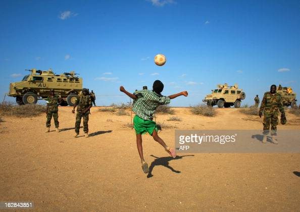 A handout picture taken and released by the African UnionUnited Nations Information Support team on February 28 2013 shows Ugandan soldiers serving...