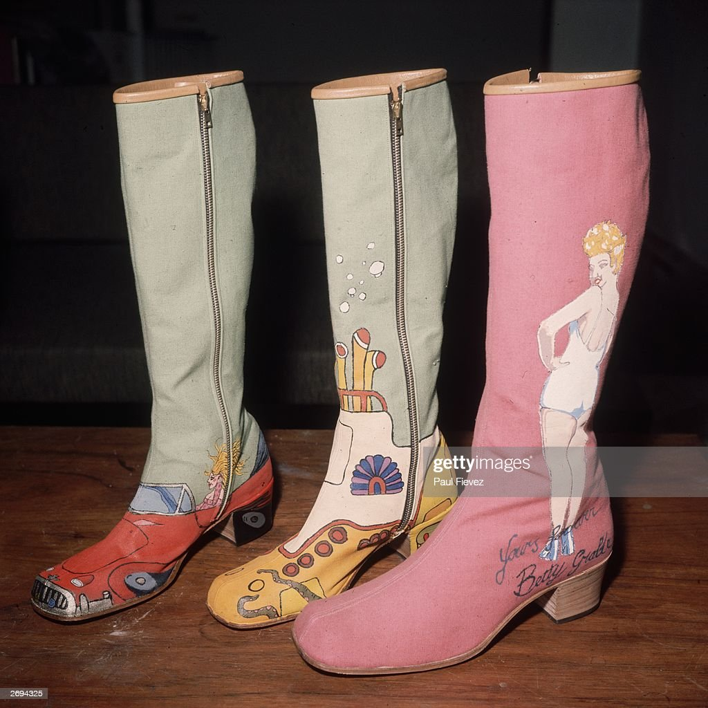 Hand-painted boots by London shoe designer Richard Evans styled on the British pop group The Beatles' animated musical film 'Yellow Submarine' and the American actress and wartime pin-up girl Betty Grable.