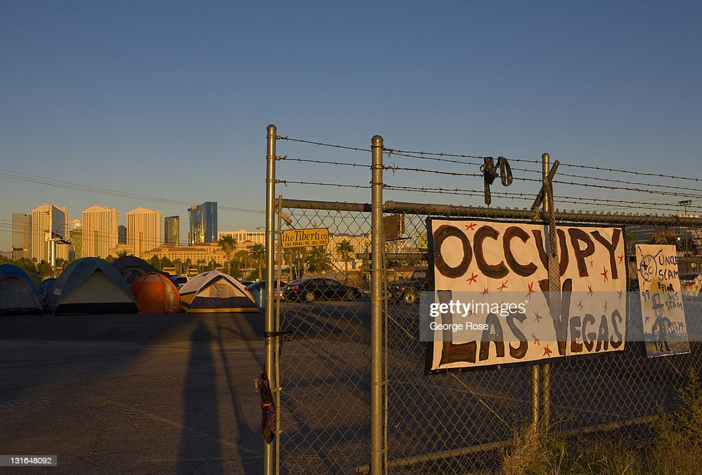 Hand-painted signs line the entrance to the Occupy Las Vegas camp on October 23, 2011 in Las Vegas, Nevada. Located a vacant lot across from the University of Nevada near McCarran International Airport, the turnout by protesters appeared on this day to be low.