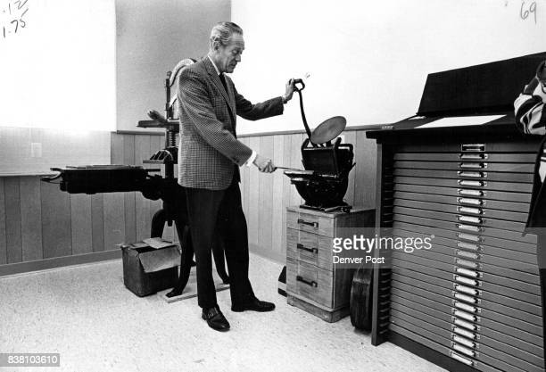 Handpress demonstrated by the chancellor is smaller version of the flatbed presses used in newspaper printing It stands next to type case Credit...