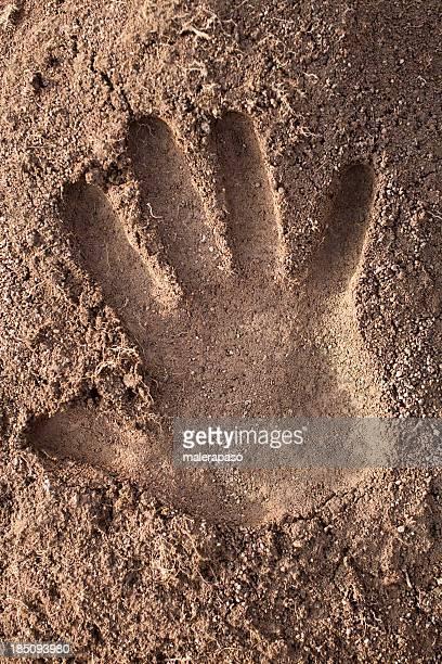 Handprint in the soil
