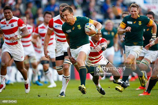 Handre Pollard of South Africa breaks through the line during the 2015 Rugby World Cup Pool B match between South Africa and Japan at the Brighton...