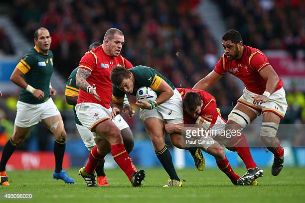 Handre Pollard of South Africa is tackled by Sam Warburton of Wales and Paul James of Wales as Taulupe Faletau of Wales watches during the 2015 Rugby...