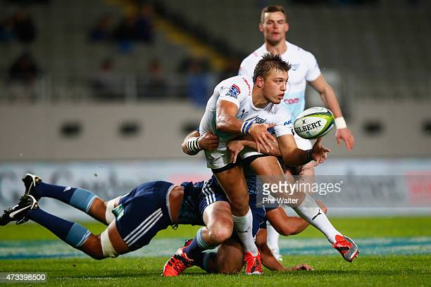 Handre Pollard of the Bulls is tackled during the round 14 Super Rugby match between the Blues and the Bulls at Eden Park on May 15 2015 in Auckland...