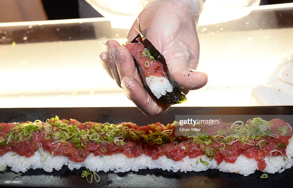 Hand-rolled bluefin tuna sushi with green onions is prepared at the barMASA restaurant booth at Vegas Uncork'd by Bon Appetit's Grand Tasting event at Caesars Palace on May 9, 2014 in Las Vegas, Nevada.