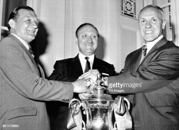 Hands across the FA Cup as new Liverpool manager Bobby Paisley receives the good wishes of club chairman John Smith and retiring manager Bill Shankly...