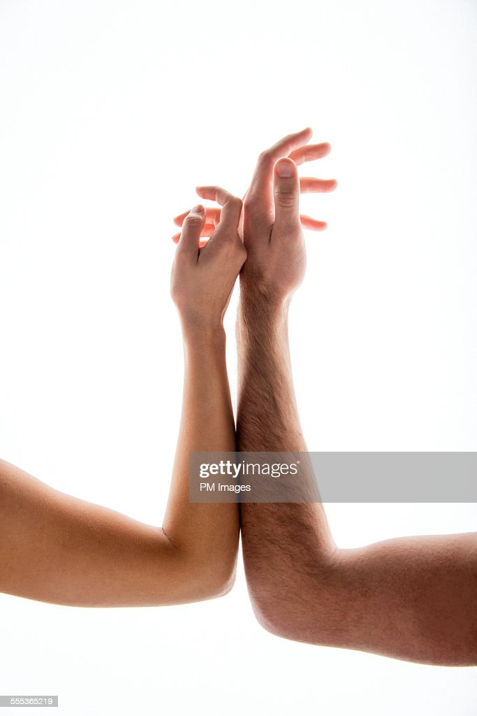 Hands and arms lightly touching