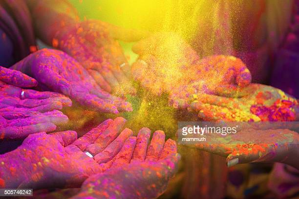 Hands and colorful powders of the holi festival