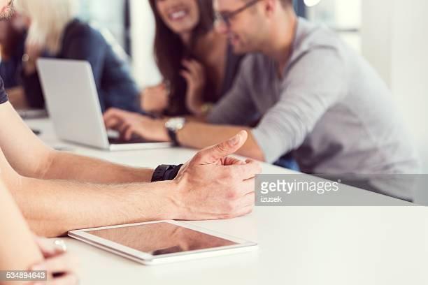 Hands and digital tablet
