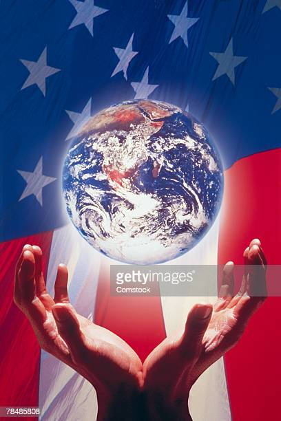 Hands and globe against American flag