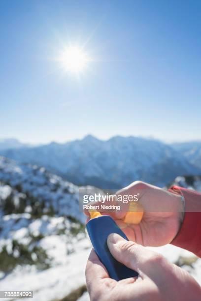Hands applying sun cream