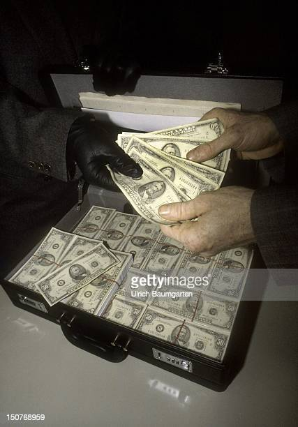 Hands are handing dollar notes over to someone
