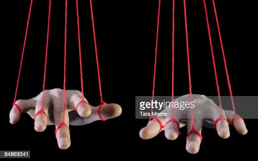 hands being supported by string