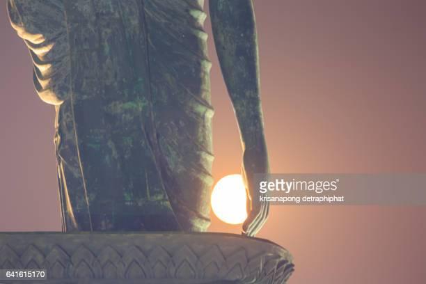 Hands BuddhaBuddha and moon.