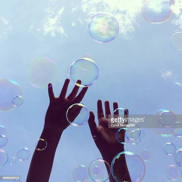 Hands Catching Bubbles