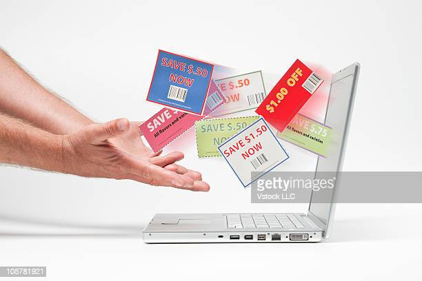 Hands catching shopping coupons