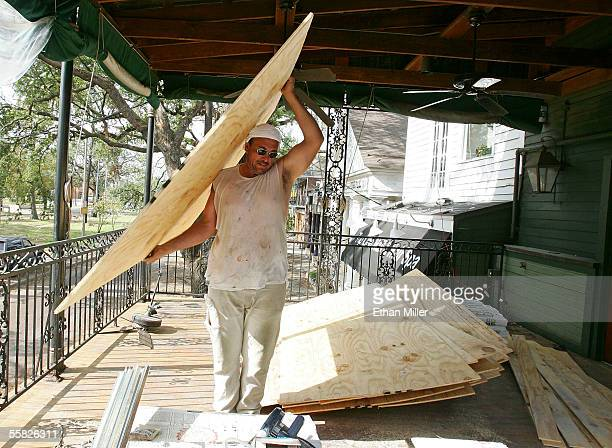 Hands Construction worker Sky Pittman carries a board to the roof of O'Henry's Food Spirits in the Riverbend District September 29 2005 in the Uptown...
