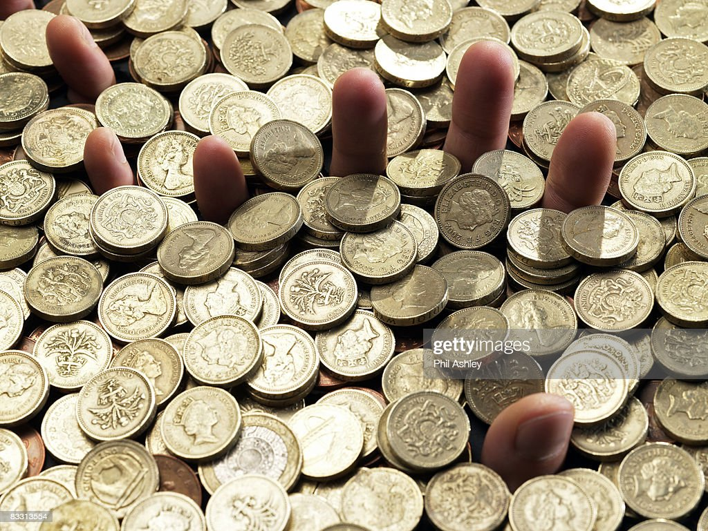 hands covered with gold coins : Stock Photo