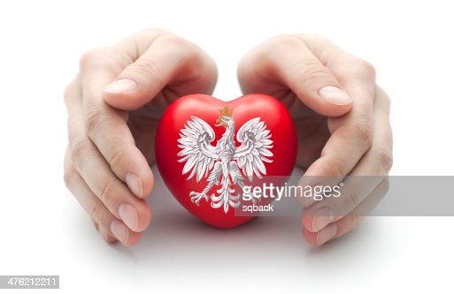 Hands covering Polish coat of arms on a red heart : Stock Photo