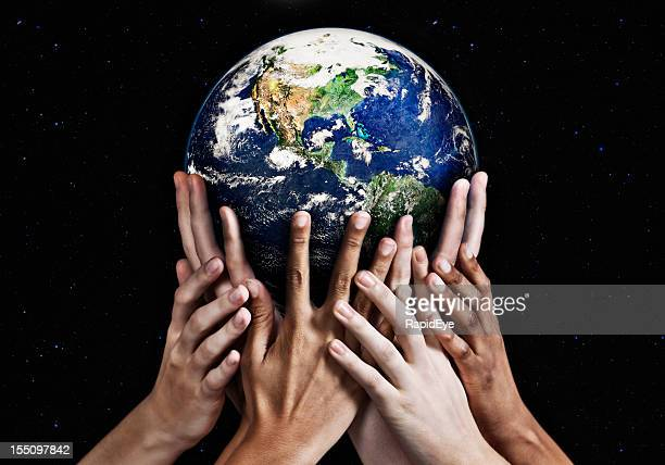 Hands cradling Mother Earth against starfield background