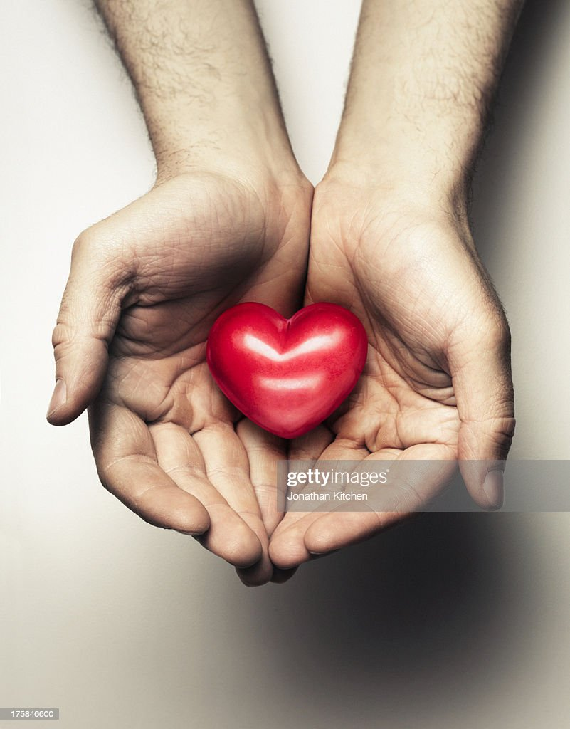 Hands Cupping a heart : Stock Photo