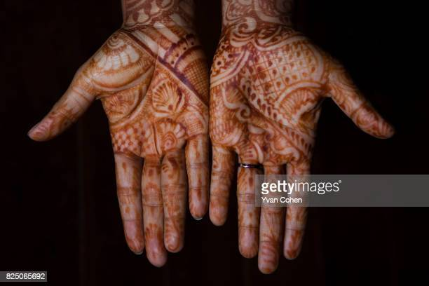 Hands decorated with a traditional henna pattern