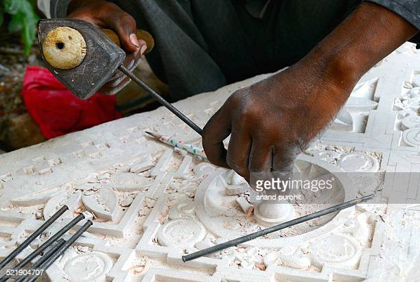 Hands doing stone carving