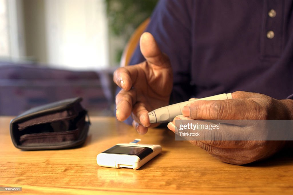 Hands drawing blood for glucose test : Stock Photo