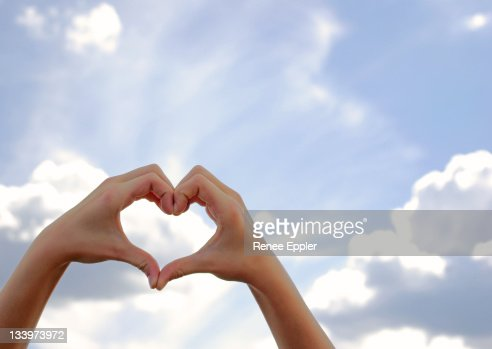 Hands formed in shape of  heart