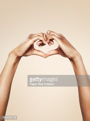 Hands forming a cute heart shape