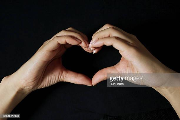 Hands forming a  heart shape,hands close-up