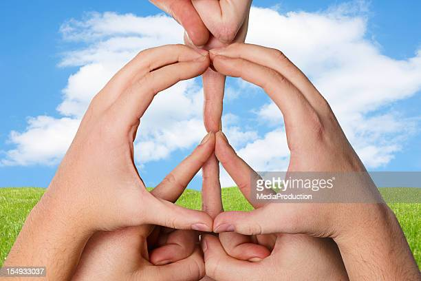 Hands forming a peace sign