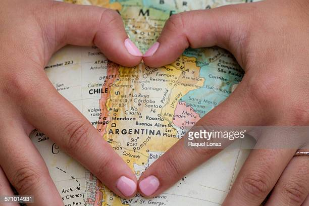 Hands forming heart shape around Argentina