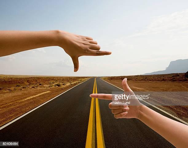 Hands framing road