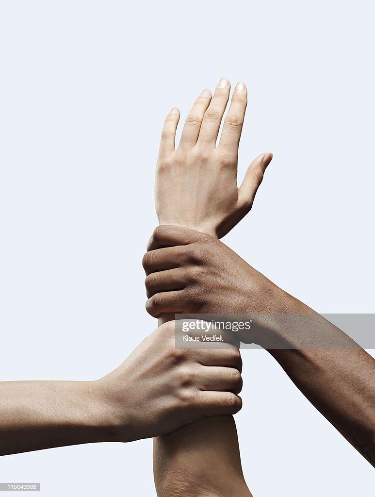 2 hands grabbing other open hand