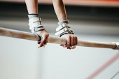 hands grips athletes female gymnast exercises on uneven bars