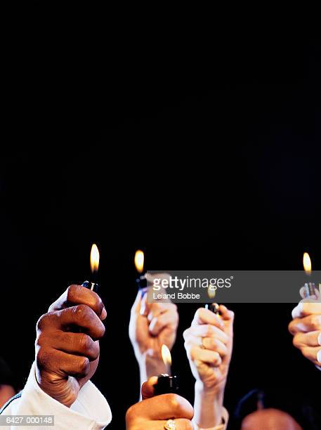 Hands Hold Cigarette Lighters
