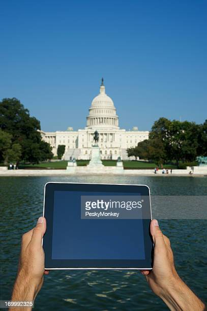 Hands Hold Digital Tablet Computer at Capitol Washington DC