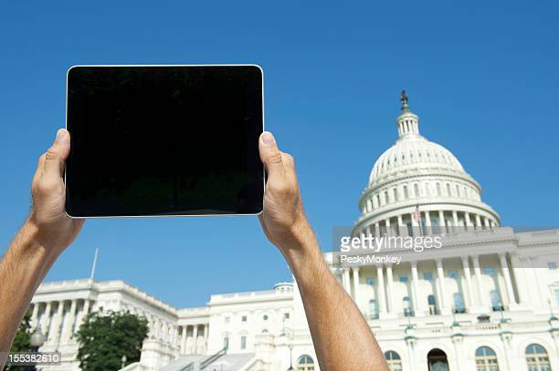Hands Hold Digital Tablet Computer at US Capitol Washington DC